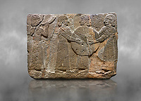 Hittite monumental relief sculpted orthostat stone panel of Procession. Basalt, Karkamıs, (Kargamıs), Carchemish (Karkemish), 900 - 700 B.C. Goddess Kubaba. Anatolian Civilisations Museum, Ankara, Turkey.<br /> <br /> Procession for. There are four figures on the other face of the orthostat. The leftmost figure plays a pipe, while the other three figures play the drums. All of the figures have long skirts and same body heights.