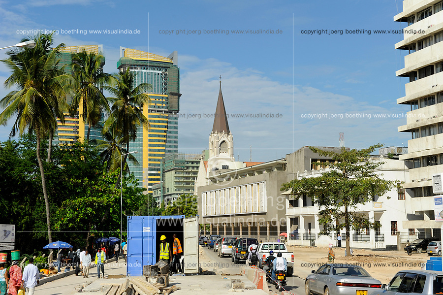 """Tanzania Dar es Salaam, road construction, new appartment buildings, cathedral  and The White Fathers' House, also known as Atiman House. It is named after the White Fathers, as the building has been the seat of their mission since 1922. The alternative name of """"Atiman"""" refers to Adrian Atiman, an African physician who was freed from slavery in Nigeria by the White Fathers and later served in Tanzania until his death, in 1924. The building is believed to have been built in the 1860s (possibly 1866) as a harem for Sultan Majid of Zanzibar. In 1922, it was sold to the White Fathers, and became their main base in East Africa, background St. Joseph´s cathedral and construction of new skyscrapers / TANSANIA Dar es Salam, Atiman House, Kathedrale und Neubau neuer Hochhaeuser"""