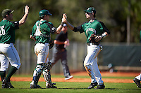 Dartmouth Big Green center fielder Trevor Johnson (36) high fives catcher Adam Gauthier (18) and Ben Socher (26) after a game against the Eastern Michigan Eagles on February 25, 2017 at North Charlotte Regional Park in Port Charlotte, Florida.  Dartmouth defeated Eastern Michigan 8-4.  (Mike Janes/Four Seam Images)