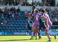 Gozie Ugwu of Wycombe Wanderers  wins the ball in the air during the Sky Bet League 2 match between Wycombe Wanderers and Plymouth Argyle at Adams Park, High Wycombe, England on 12 September 2015. Photo by Andy Rowland.