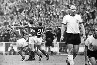 30 07 1966  Hartung goal celebration England with v left 30.07.1966. Wembley Stadium, London England. 1966 World Cup final England versus Germany (4-2) After Extra time.  Alan Ball Martin Peters and Roger Hunt celebrate as Uwe Seeler left and Willi Schulz both Germany look dejected