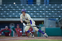 Will Prater (5) of the Western Carolina Catamounts lays down a bunt against the Saint Joseph's Hawks at TicketReturn.com Field at Pelicans Ballpark on February 23, 2020 in Myrtle Beach, South Carolina. The Hawks defeated the Catamounts 9-2. (Brian Westerholt/Four Seam Images)