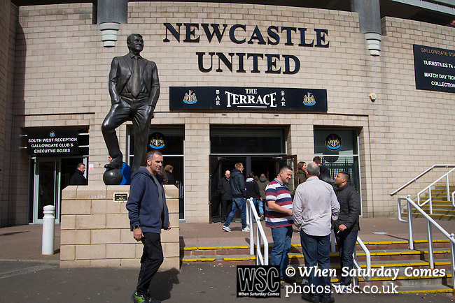 Newcastle United 1 Tottenham Hotspur 3 19/04/2015. St James Park, Premier League. Supporters gathering underneath a statue to former manager Sir Bobby Robson, situated outside the Milburn Stand of the stadium before Newcastle United host Tottenham Hotspurs in an English Premier League match at St. James' Park. The match was boycotted by a section of the home support critical of the role of owner Mike Ashley and sponsorship by a payday loan company. The match was won by Spurs by 3-1, watched by 47,427, the lowest league gate of the season at the stadium. Photo by Colin McPherson.