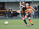 United's Gary Mackay Steven takes a shot as Alloa's Darren Young tries to block.