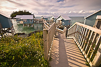 Small wooden houses placed on top of the water in the Seven Beaches resort in Bermuda, Atlantic Ocean