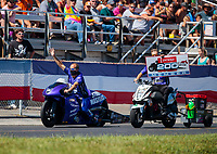 Sep 5, 2020; Clermont, Indiana, United States; NHRA pro stock motorcycle rider Scotty Pollacheck celebrates after joining the Denso 200mph club during qualifying for the US Nationals at Lucas Oil Raceway. Mandatory Credit: Mark J. Rebilas-USA TODAY Sports