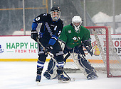Brockport Blue Devils Cody Johnson (3) in front of Notre Dame Fighting Irish of Batavia goalie Tyler Stroud (31) during a varsity ice hockey game during the Section V Rivalry portion of the Frozen Frontier outdoor hockey event at Frontier Field on December 22, 2013 in Rochester, New York.  (Copyright Mike Janes Photography)