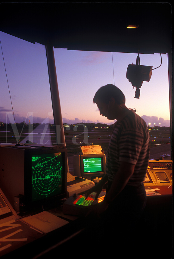 Air traffic controller in control tower.