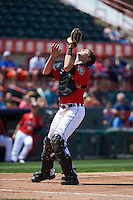 Erie Seawolves catcher Grayson Greiner (51) catches a popup during a game against the Altoona Curve on July 10, 2016 at Jerry Uht Park in Erie, Pennsylvania.  Altoona defeated Erie 7-3.  (Mike Janes/Four Seam Images)
