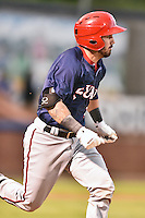 Hagerstown Suns catcher Matt Reistetter (11) runs to first during a game against the  Asheville Tourists at McCormick Field on September 2, 2016 in Asheville, North Carolina. The Suns defeated the Tourists 5-1. (Tony Farlow/Four Seam Images)