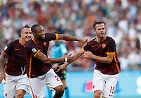 Calcio, Serie A: Roma vs Juventus. Roma, stadio Olimpico, 30 agosto 2015.<br /> Roma's Miralem Pjanic, right, celebrates with teammate Seydou Keita, center, and Roma's Radja Nainggolan, after scoring during the Italian Serie A football match between Roma and Juventus at Rome's Olympic stadium, 30 August 2015.<br /> UPDATE IMAGES PRESS/Riccardo De Luca