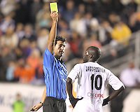 Kendall Jagdeosingh #10 of the Puerto Rica Islanders receives a yellow card from referee Fotis Bazakos during the second leg of the USSF-D2 championship match against theCarolina Railhawks at WakeMed Soccer Park, in Cary, North Carolina on October 30 2010. The game ended 1-1, Puerto Rico won 3-1 on overall goals.