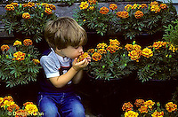 FA01-028z  Child smelling marigolds