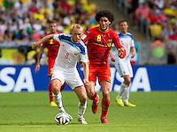 Denis Glushakov of Russia and Marouane Fellaini of Belgium