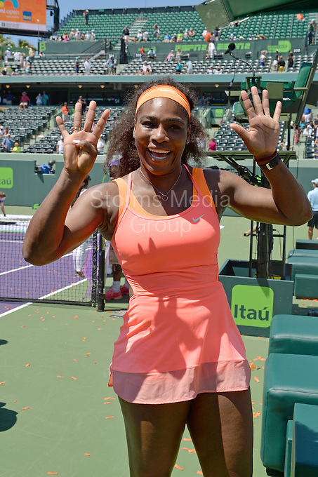 KEY BISCAYNE, FL - APRIL 04: Serena Williams completely overpowered Carla Suarez Navarro to win the Miami Open for an eighth time after defeating Carla Suarez Navarro of Spain. All business After winning the Miami Open for the 8th time Serena flashes the nine win sign as she apparently already has next year's tournament in her sights on day 13 of the Miami Open at Crandon Park Tennis Center on April 4, 2015 in Key Biscayne, Florida<br /> <br /> <br /> People:  Serena Williams<br /> <br /> Transmission Ref:  FLXX<br /> <br /> Must call if interested<br /> Michael Storms<br /> Storms Media Group Inc.<br /> 305-632-3400 - Cell<br /> 305-513-5783 - Fax<br /> MikeStorm@aol.com