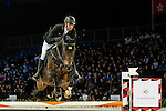 Marco Kutscher of Germany riding on Caramsin competes during the EEM Trophy, part of the Longines Masters of Hong Kong on 10 February 2017 at the Asia World Expo in Hong Kong, China. Photo by Marcio Rodrigo Machado / Power Sport Images
