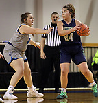 March 13, 2021— Parker Easy #24 of Providence (Mont.) looks past Dakota State defender Morgan Koepsell #45 during NAIA Women's Opening Championship Rounds at Sokol Arena in Omaha, Nebraska (Photo by Richard Carlson/inertia)