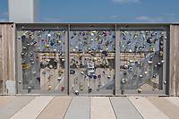 Oklahoma City, Oklahoma. Scissortail Park, Padlocks Pledging Eternal Love on Railings of Skydance Bridge, Scissortail Bridge, Completed 2012. Interstate Highway I-40, Crosstown Expressway, seen below.