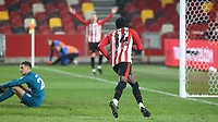 Brentford's Josh DaSilva runs towards Sergi Canos to celebrate scoring their opening goal during Brentford vs Newcastle United, Carabao Cup Football at the Brentford Community Stadium on 22nd December 2020