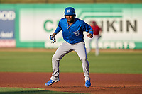 Dunedin Blue Jays Orelvis Martinez (11) leads off first base during a game against the Clearwater Threshers on May 20, 2021 at BayCare Ballpark in Clearwater, Florida.  (Mike Janes/Four Seam Images)