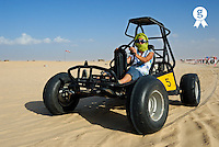 Woman riding beach buggy in desert (Licence this image exclusively with Getty: http://www.gettyimages.com/detail/85071235 )