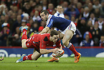 Center George North dives over to score the first try of the match for Wales despite the efforts of French scrum half Jean-Marc Doussain to stop him.<br /> RBS 6 Nations 2014<br /> Wales v France<br /> Millennium Stadium<br /> 21.02.14<br /> <br /> ©Steve Pope-SPORTINGWALES