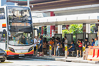 Singapore, Passengers Boarding a Bus on Orchard Road.