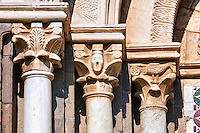 Romanesque columns and sculpted Anthropomorphic capitals of main entrance of the 8th century Romanesque Basilica church of St Peters, Tuscania, Lazio, Italy