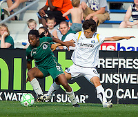 St Louis Athletica defender Sheree Gray (5) works the ball away from Los Angeles Sol midfielder Aya Miyama (8) during a WPS match at Hermann Stadium, in St. Louis, MO, April 25 2009. The match ended in a 0-0 tie.