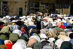 Shiite muslims participate in Friday prayers in Sadr City on July 2, 2004.  (photo by Khampha Bouaphanh)
