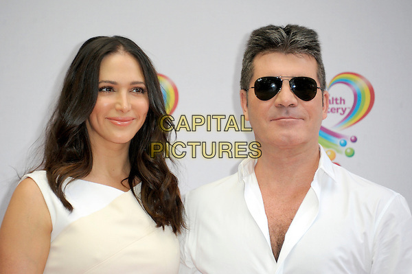 LONDON, ENGLAND - JUNE 02: Lauren Silverman & Simon Cowell attends the Health Lottery Tea Party at The Savoy Hotel on June 2, 2014 in London, England.<br /> CAP/CJ<br /> ©Chris Joseph/Capital Pictures