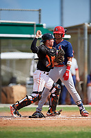 GCL Marlins catcher Keegan Fish (6) throws to third base in front of Zack Gahagan (38) during a game against the GCL Cardinals on August 4, 2018 at Roger Dean Chevrolet Stadium in Jupiter, Florida.  GCL Marlins defeated GCL Cardinals 6-3.  (Mike Janes/Four Seam Images)