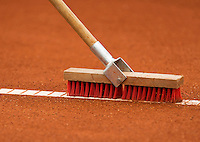 10-07-12, Netherlands, Den Haag, Tennis, ITS, HealthCity Open, Clay Court management, cleaning lines on clay court with a brush