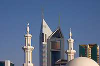 Dubai, United Arab Emirates. Emirates Towers with the dome and minarets of a mosque in the foreground. Sheikh Zayed Road, the Abu Dhabi Road, .