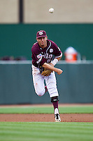 Texas A&M Aggies shortstop Mikey Reynolds (16) makes a throw to first base against the LSU Tigers in the NCAA Southeastern Conference baseball game on May 10, 2013 at Blue Bell Park in College Station, Texas. LSU defeated Texas A&M 7-4. (Andrew Woolley/Four Seam Images).