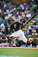 Pittsburgh Pirates second baseman Chris Bostick (63) follows through on a swing during a Grapefruit League Spring Training game against the New York Yankees on March 6, 2017 at LECOM Park in Bradenton, Florida.  Pittsburgh defeated New York 13-1.  (Mike Janes/Four Seam Images)