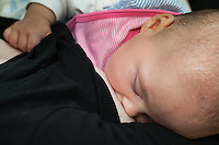 Close-up of a baby breastfeeding at a breastfeeding support group.<br /> <br /> 20/06/2011<br /> Hampshire, England, UK