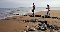 Pictured: Twelve year old Nikolas Ioan followed by his seven year old sister Sophie in Swansea Bay in the early evening of Saturday 07 May 2016<br /> Re: Sunshine and high temperatures have been forecast for most of the UK.