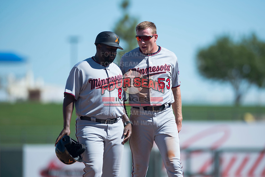 Salt River Rafters left fielder Luke Raley (53) talks to manager Tommy Watkins (8), both of the Minnesota Twins organization, as they walk off the field between innings of an Arizona Fall League game against the Surprise Saguaros on October 9, 2018 at Surprise Stadium in Surprise, Arizona. The Rafters defeated the Saguaros 10-8. (Zachary Lucy/Four Seam Images)
