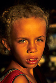 Itaparica, Brazil. Sad young girl with plaited blonde hair and green eyes.