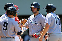 Columbus Clippers infielder Russ Canzler #28 is greeted by teammates following a home run during a game versus the Pawtucket Red Sox at McCoy Stadium in Pawtucket, Rhode Island on May 13, 2012.   (Ken Babbitt/Four Seam Images)