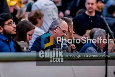 16 March 2019: University of Vermont Catamount PA Announcer Steve Gentile works the game as UVM hosts the UMBC Retrievers in the America East Championship Game at Patrick Gymnasium in Burlington, Vermont. The Catamounts defeated the Retrievers 66-49, avenging their loss against the same team in last years' Championship Game. Mandatory Credit: Ed Wolfstein Photo *** RAW (NEF) Image File Available ***