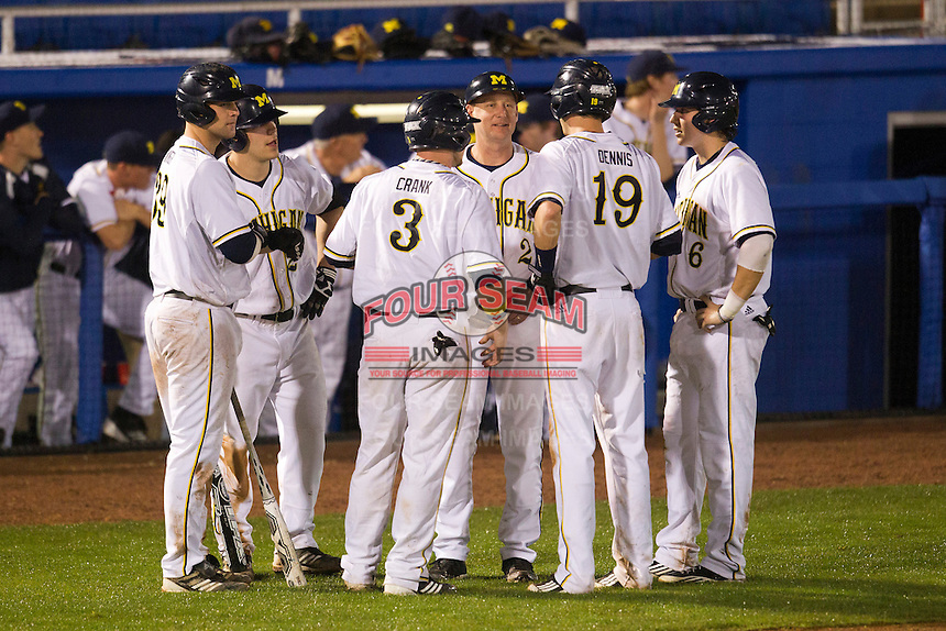 Michigan Wolverines head coach Rich Maloney #2 talks with Derek Dennis #19, Coley Crank #3, John Lorenz #6, Brett Winger #39 and Patrick Biondi #26 during a game against the Pittsburgh Panthers at the Big Ten/Big East Challenge at Florida Auto Exchange Stadium on February 18, 2012 in Dunedin, Florida.  (Mike Janes/Four Seam Images)