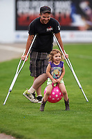 Batavia Muckdogs young fan partakes in an on field promotion during a game against the Williamsport Crosscutters on August 29, 2015 at Dwyer Stadium in Batavia, New York.  Williamsport defeated Batavia 7-3.  (Mike Janes/Four Seam Images)
