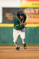 Justin Twine (1) of the Greensboro Grasshoppers takes off For third base against the Hickory Crawdads at L.P. Frans Stadium on May 6, 2015 in Hickory, North Carolina.  The Crawdads defeated the Grasshoppers 1-0.  (Brian Westerholt/Four Seam Images)