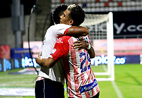BARRANQUILLA - COLOMBIA, 08-11-2020: Miguel Angel Borja de Atletico Junior, celebra con Teofilo Gutierrez despues de anotar su gol a Alianza Petrolera, durante partido entre Atletico Junior y Alianza Petrolera, de la fecha 18 por la Liga BetPlay DIMAYOR 2020 jugado en el estadio Romelio Martinez de la ciudad de Barranquilla. / Miguel Angel Borja of Atletico Junior celebrates with Teofilo Gutierrez after scoring his goal to Alianza Petrolera, during a match between Atletico Junior and Alianza Petrolera of the 18th date for the BetPlay DIMAYOR Leguaje 2020 played at the Romelio Martinez Stadium in Barranquilla city. / Photo: VizzorImage / Jairo Cassiani / Cont.