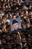 Punjab, Pakistan<br /> November 11, 1988<br /> <br /> The images of Ali Bhutto, Benazir's father and former Prime Minister, is displayed at a Bhutto campaign rally.<br /> <br /> Bhutto, the eldest child of former Pakistan President and Prime Minister Zulfikar Ali Bhutto, found herself placed under house arrest in the wake of her father?s imprisonment and subsequent execution in 1979. In 1984 she became the leader in exile of the Pakistan Peoples Party (PPP), her father's party, though she was unable to make her political presence felt in Pakistan until after the death of General Muhammad Zia-ul-Haq. <br /> <br /> On 16 November 1988 Benazir's PPP won the largest bloc of seats in the National Assembly. Bhutto was sworn in as Prime Minister in December, at age 35 she became the first woman to head the government of a Muslim-majority state in modern times. <br /> <br /> She was removed from office 20 months later under orders of then-president Ghulam Ishaq Khan for alleged corruption. Bhutto was re-elected in 1993 but was again removed by President Farooq Leghari in 1996, on similar charges. Bhutto went into self-imposed exile in Dubai in 1998, until she returned to Pakistan on October 2007, after General Musharraf granted her amnesty and all corruption charges withdrawn.