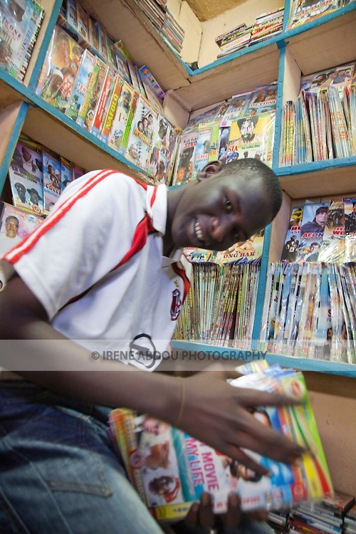 A boy mans a small shop in the Grand Marche of Bamako, Mali that sells bootleg music and DVDs.