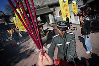 CHINA. Worshippers during Chinese New Year in Baiyun Temple in Beijing.  Chinese New Year, or Spring Festival, is the most important festival and holiday in the Chinese calendar In mainland China, many people use this holiday to visit family and friends and also visit local temples to offer prayers to their ancestors. The roots of Chinese New Year lie in combined influences from Buddhism, Taoism, Confucianism, and folk religions.  2008..