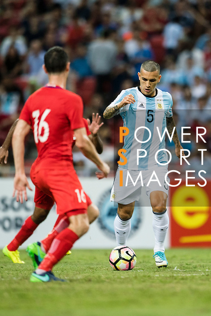 Leandro Paredes of Argentina (R) in action during the International Test match between Argentina and Singapore at National Stadium on June 13, 2017 in Singapore. Photo by Marcio Rodrigo Machado / Power Sport Images